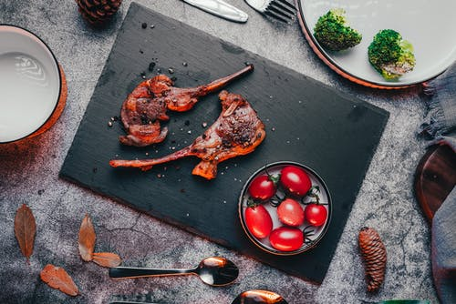 Grilled Meat on Black Wooden Chopping Board