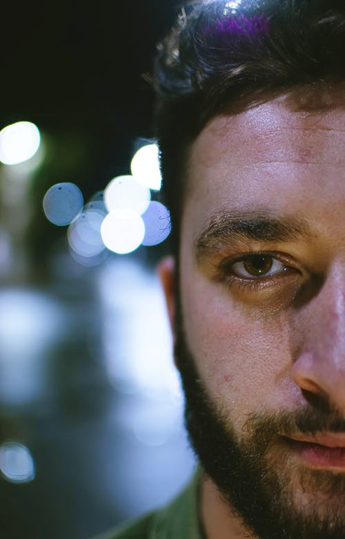 Mans Face in Close Up Photography