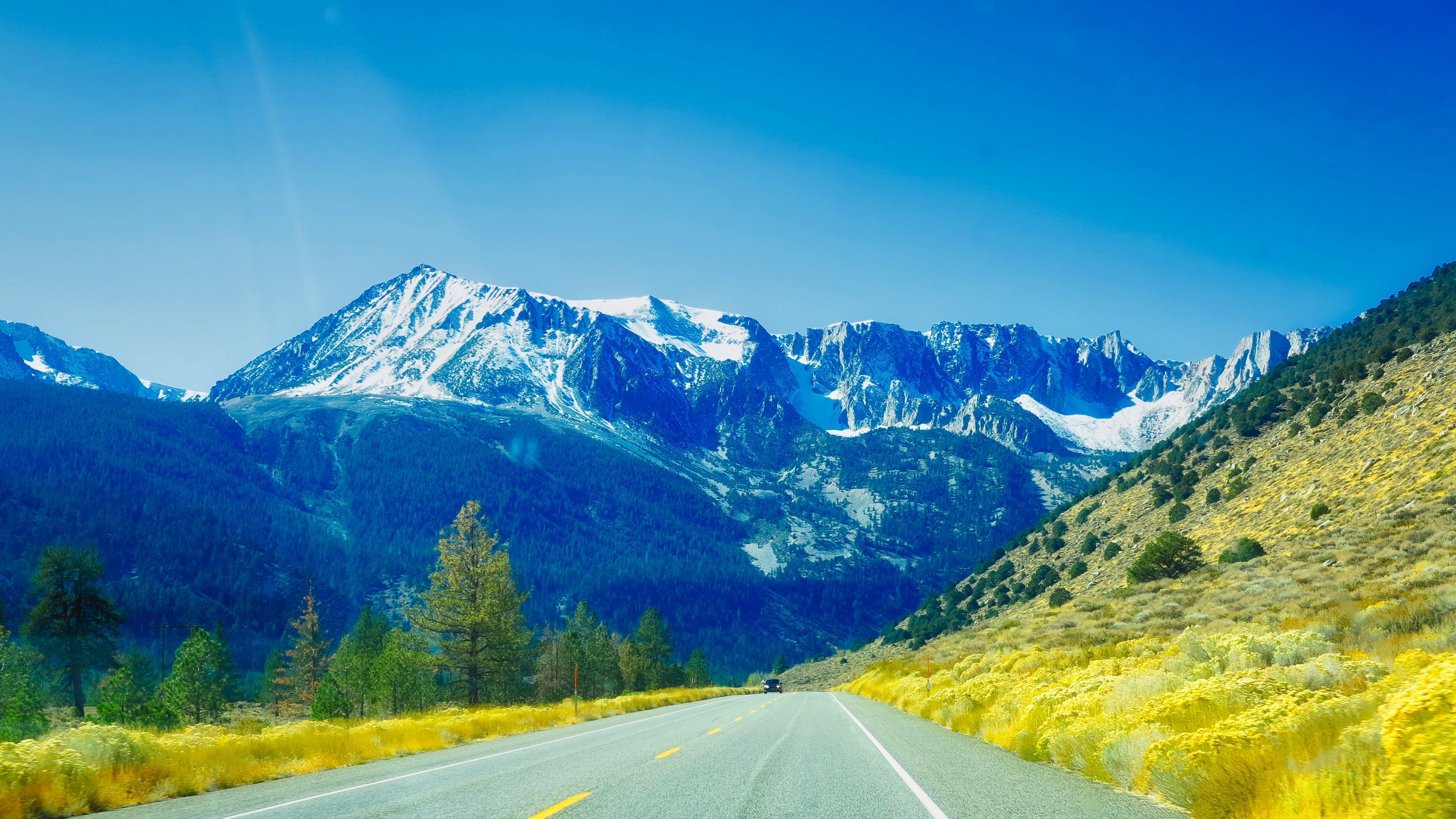 Grey Concrete Road Towards Mountain