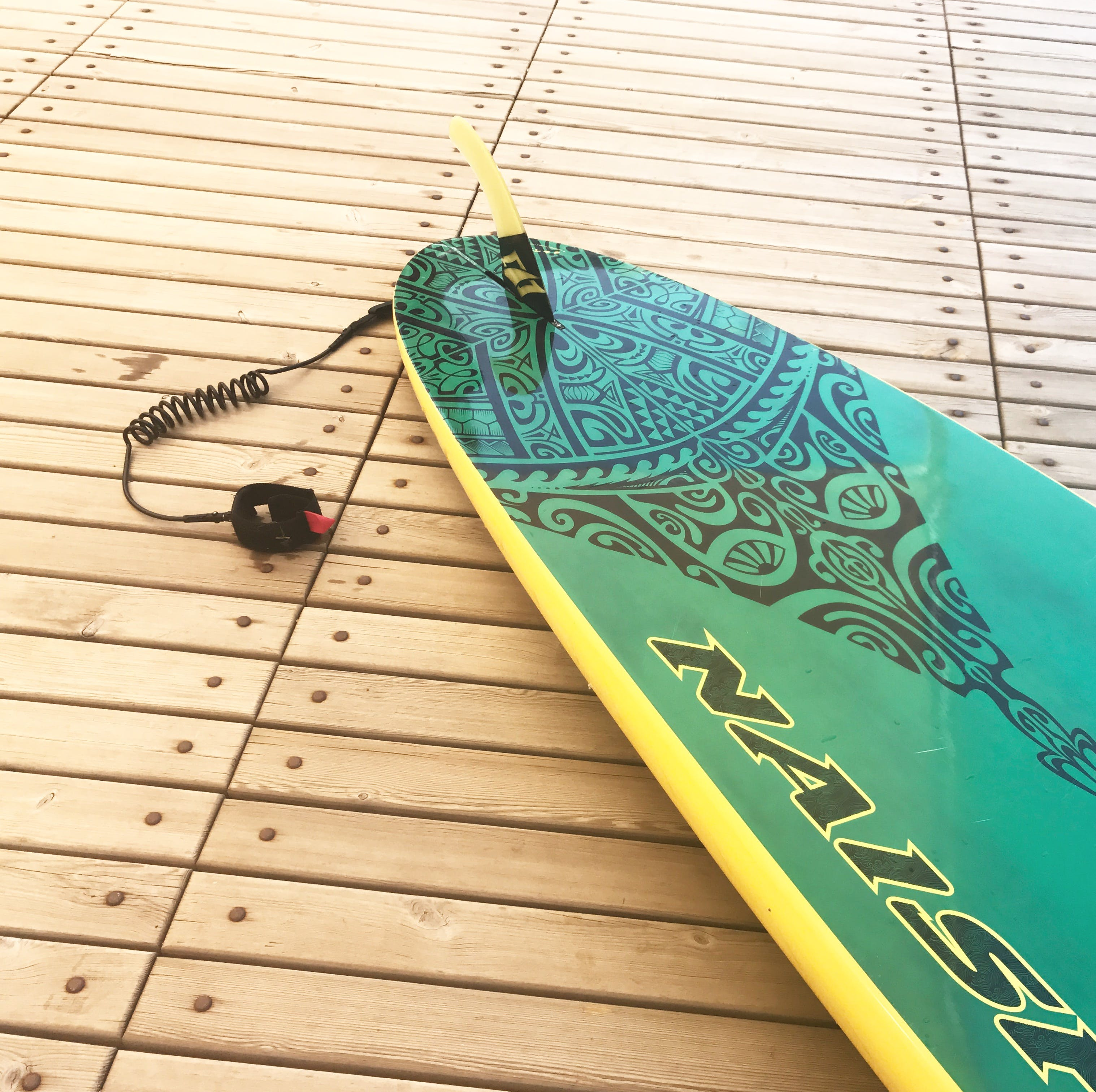 Green and Yellow Surfboard