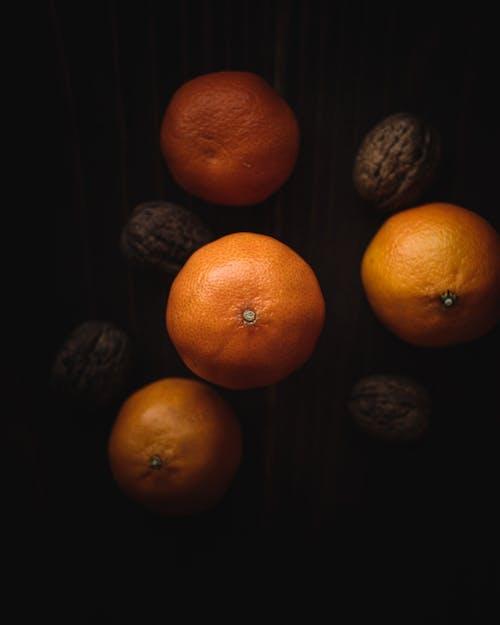 Orange Fruits on Black Surface