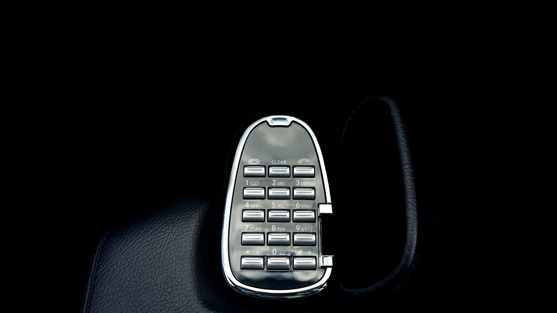 Gray Remote Control on Black Holder