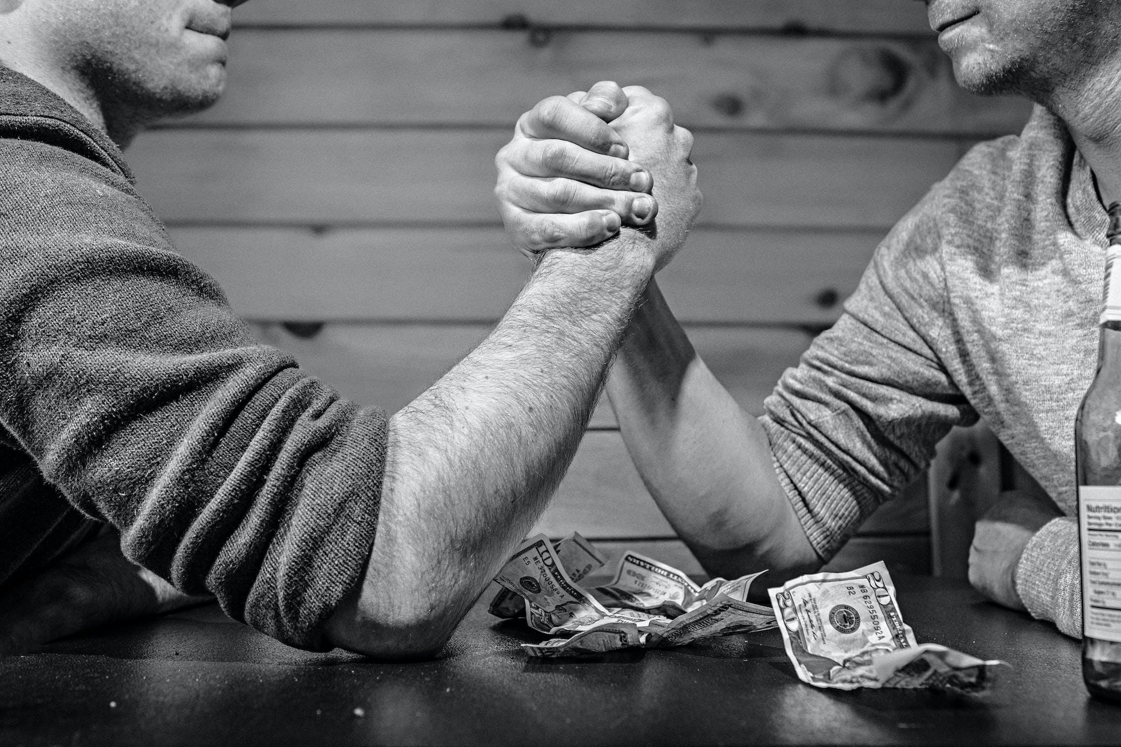 Two men hand wrestling