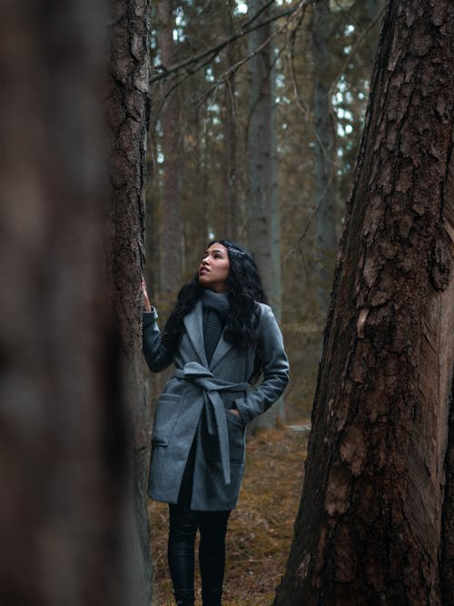Woman in Gray Coat Standing Beside Brown Tree