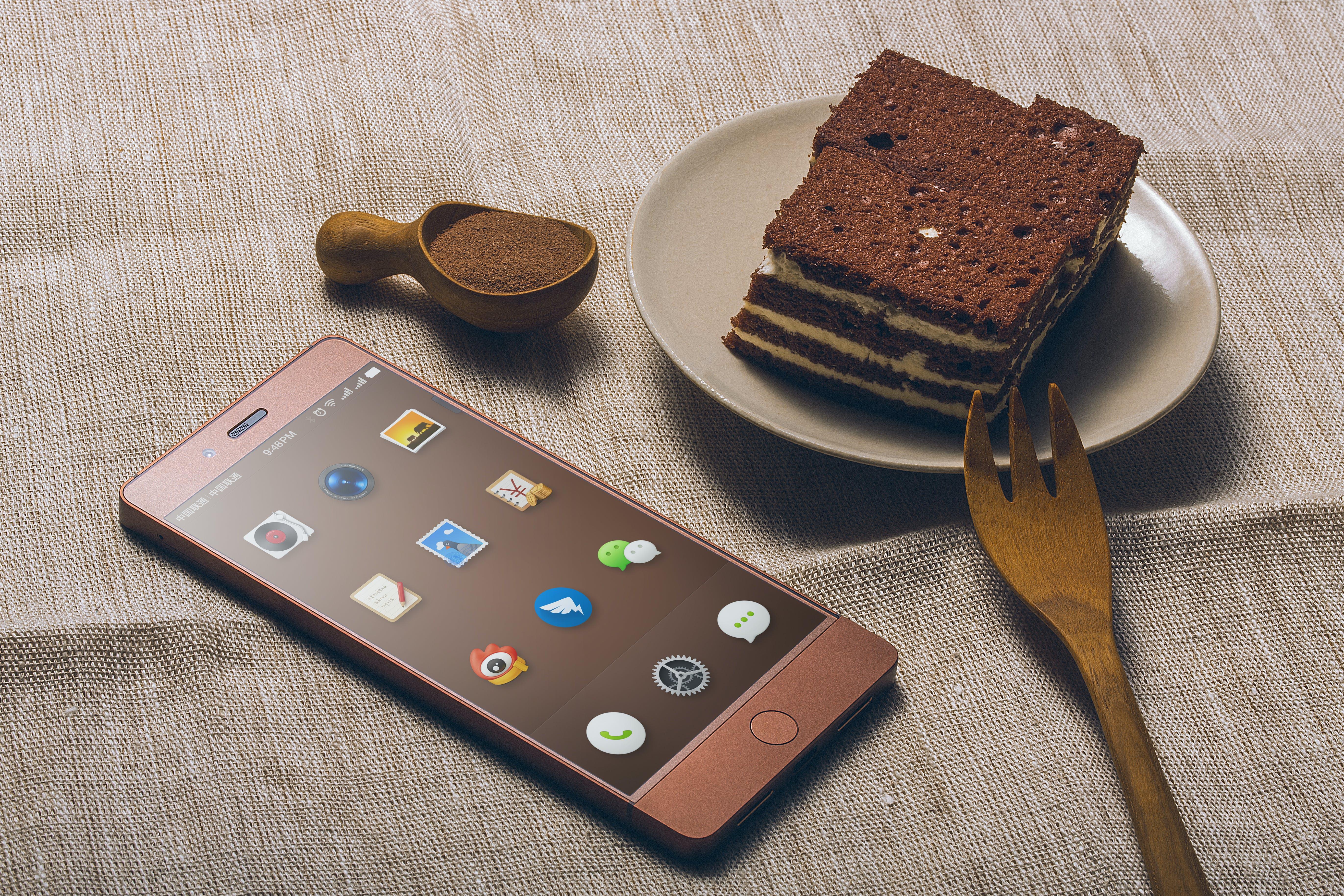 Chocolate Cake on Saucer Beside Iphone