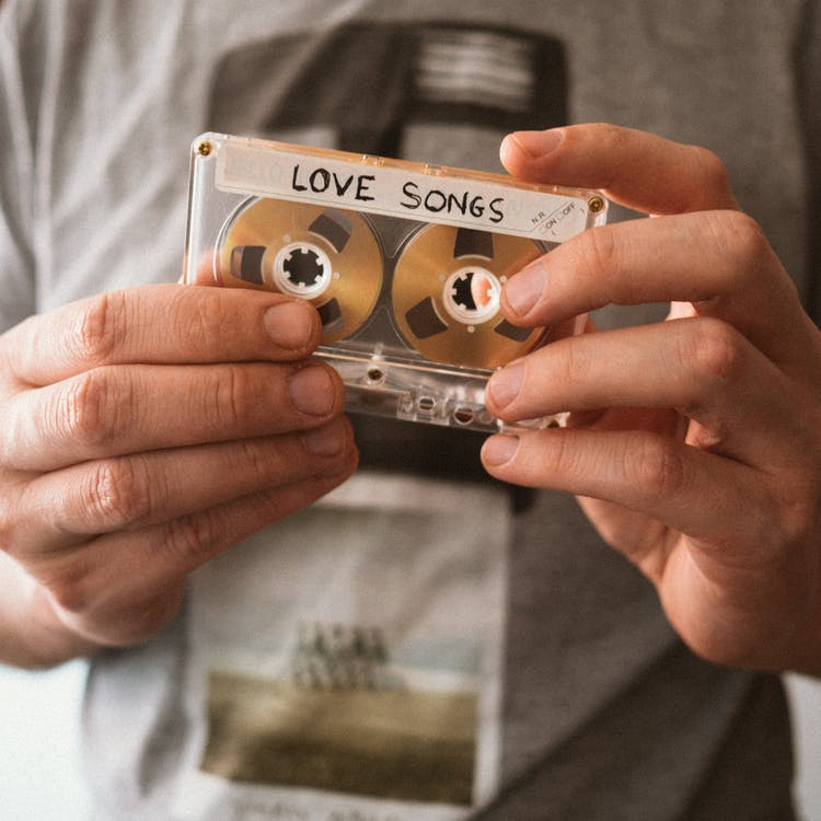 Person Holding A Cassette Tape