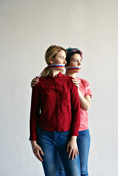 Woman with short hair embracing girlfriend