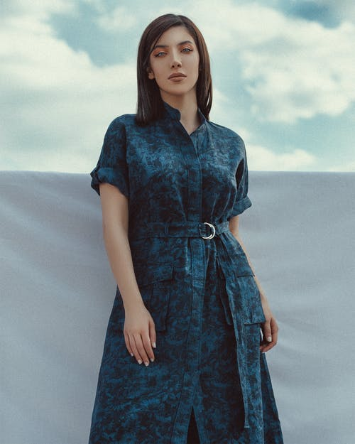Woman in Blue Dress Standing