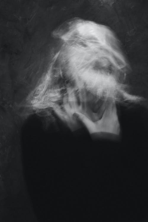 Grayscale Photo of Woman in Black Shirt