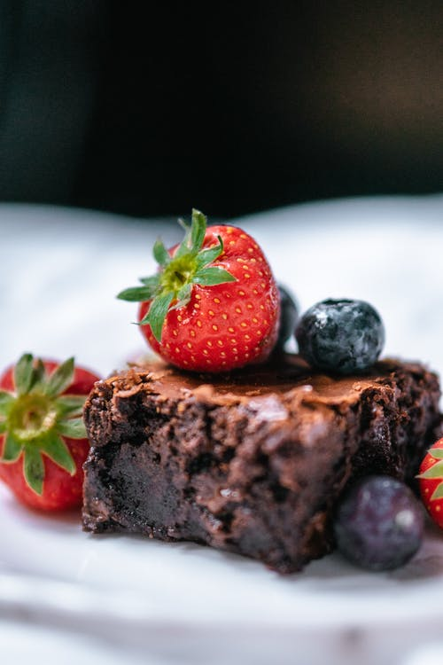 Slice of chocolate dessert with fresh berries