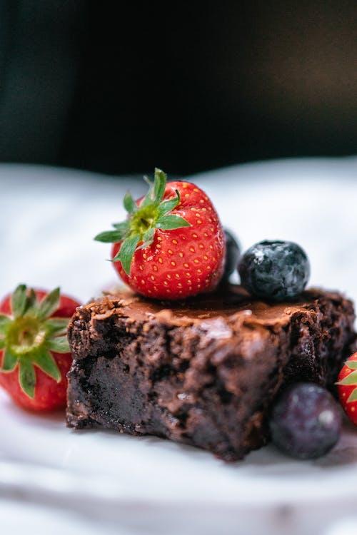 Slice of chocolate dessert with fresh berries