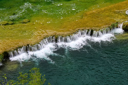 Small waterfall of vast clean river