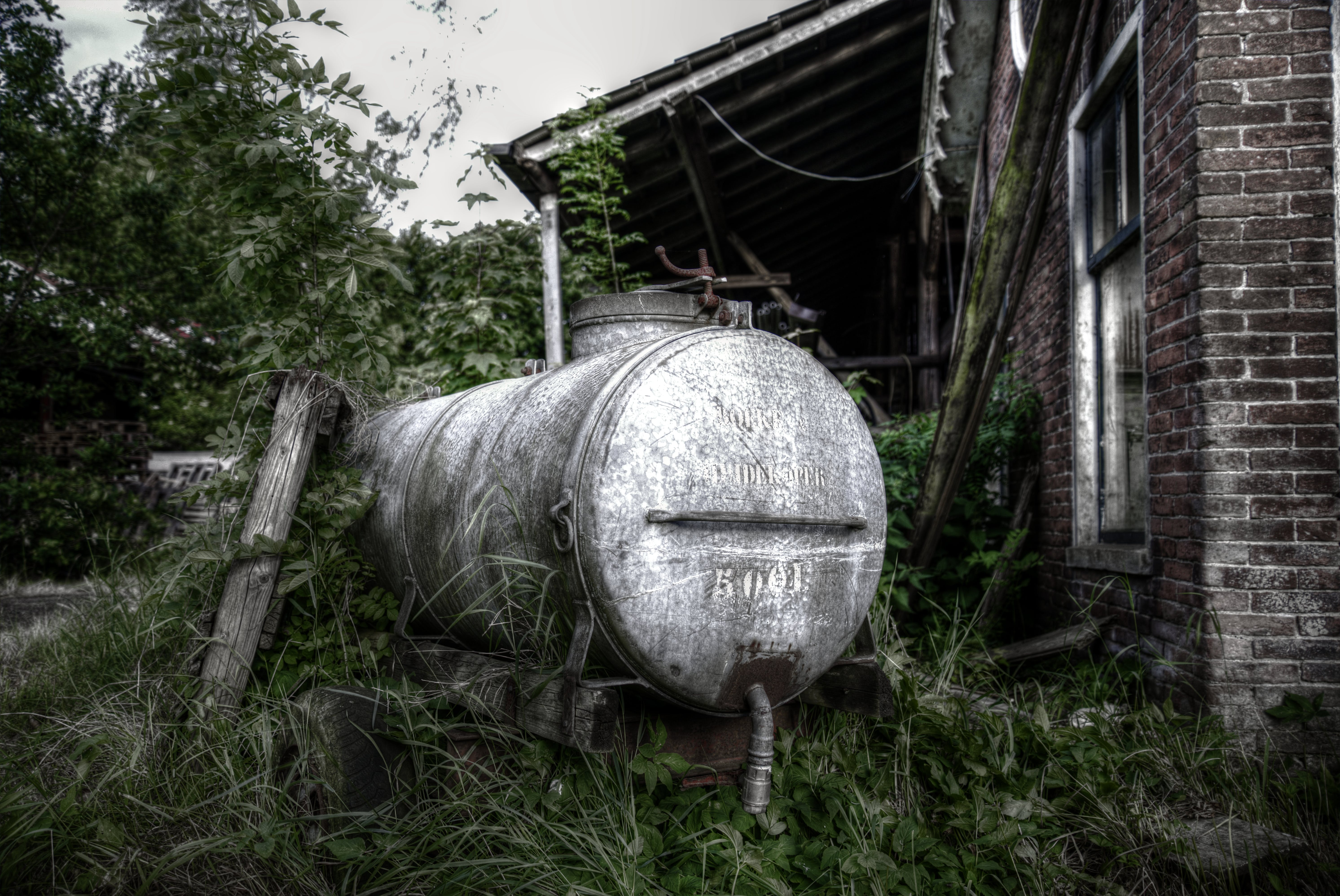 Photo of White Septic Tank Near Brown House