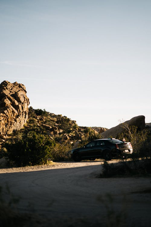Car parked near stony hill in semidesert