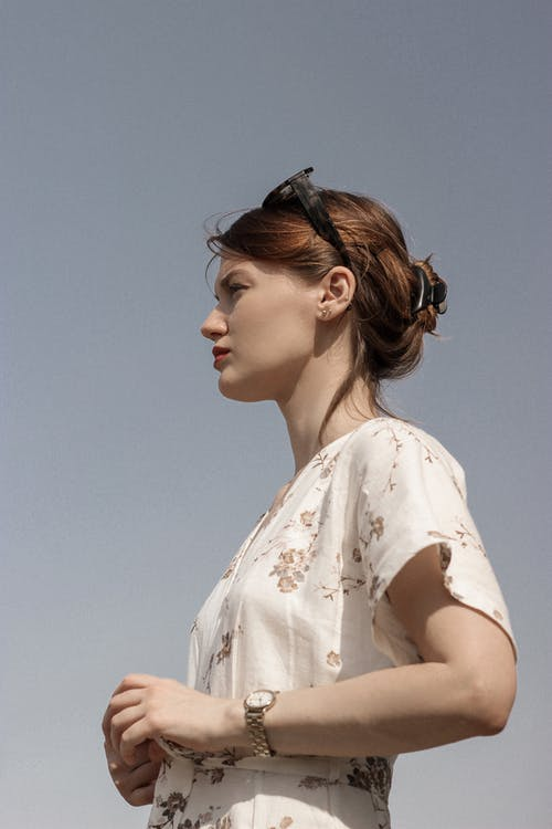 Woman in White Floral Shirt