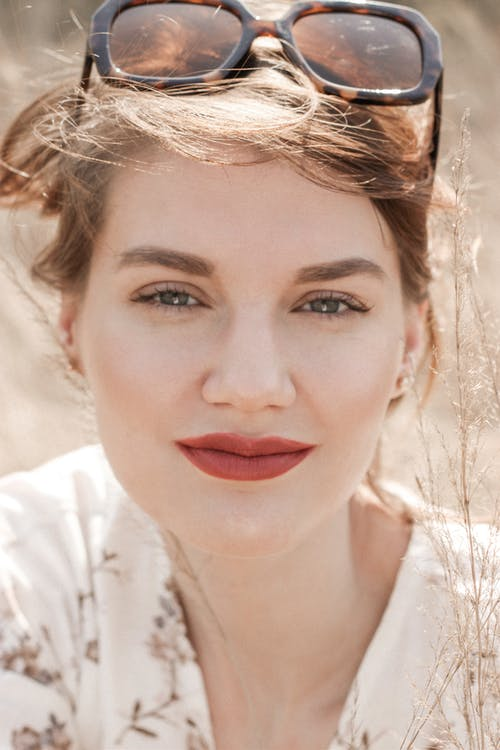 Woman in White Shirt With Red Lipstick