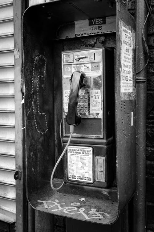 Grayscale Photo of Telephone Booth