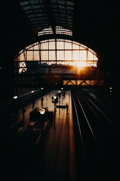 Railway station with arched ceiling at sunset