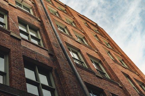 Facade of residential brick building in city