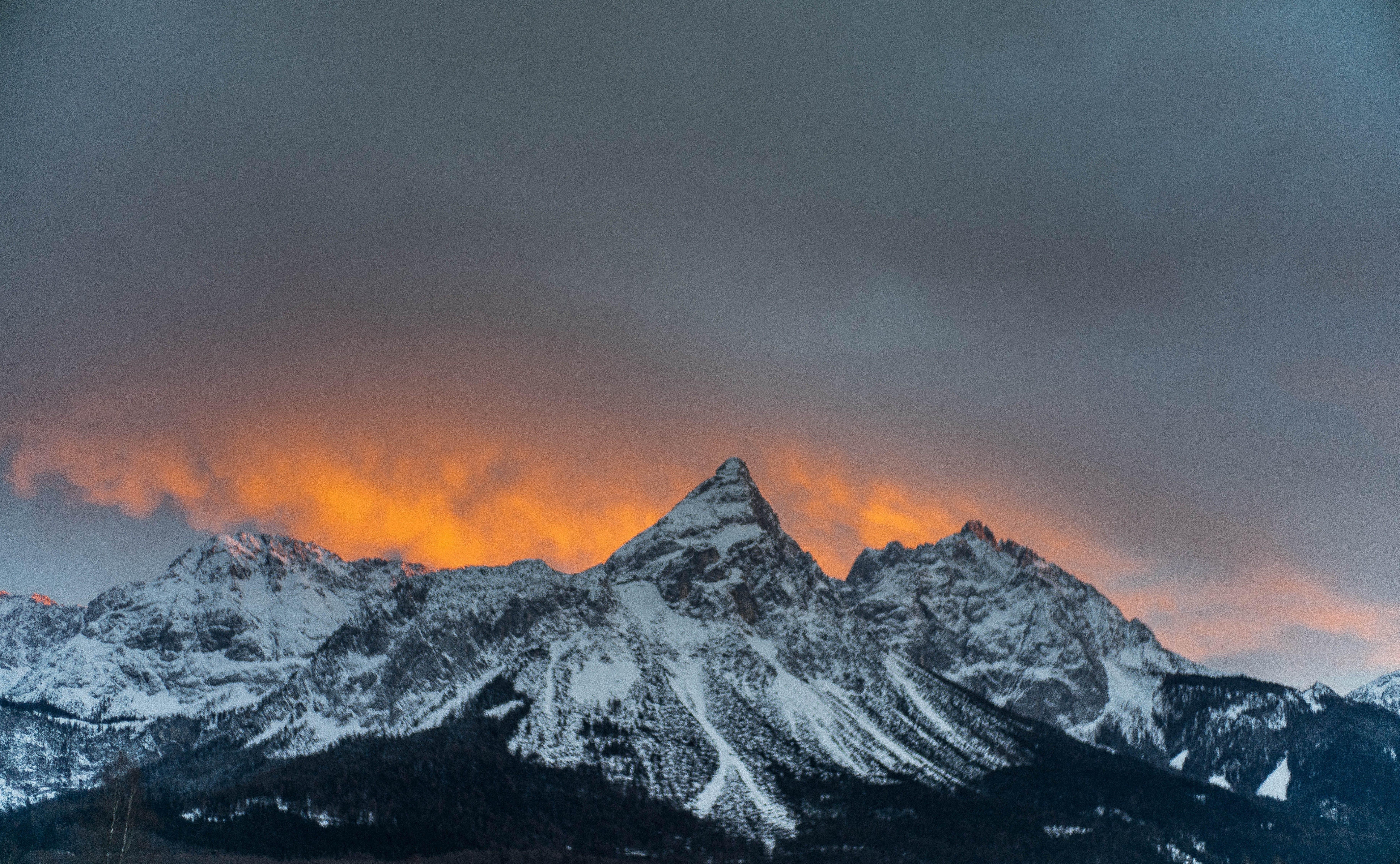 Snowy Mountain Under Dark Cloudy Sky