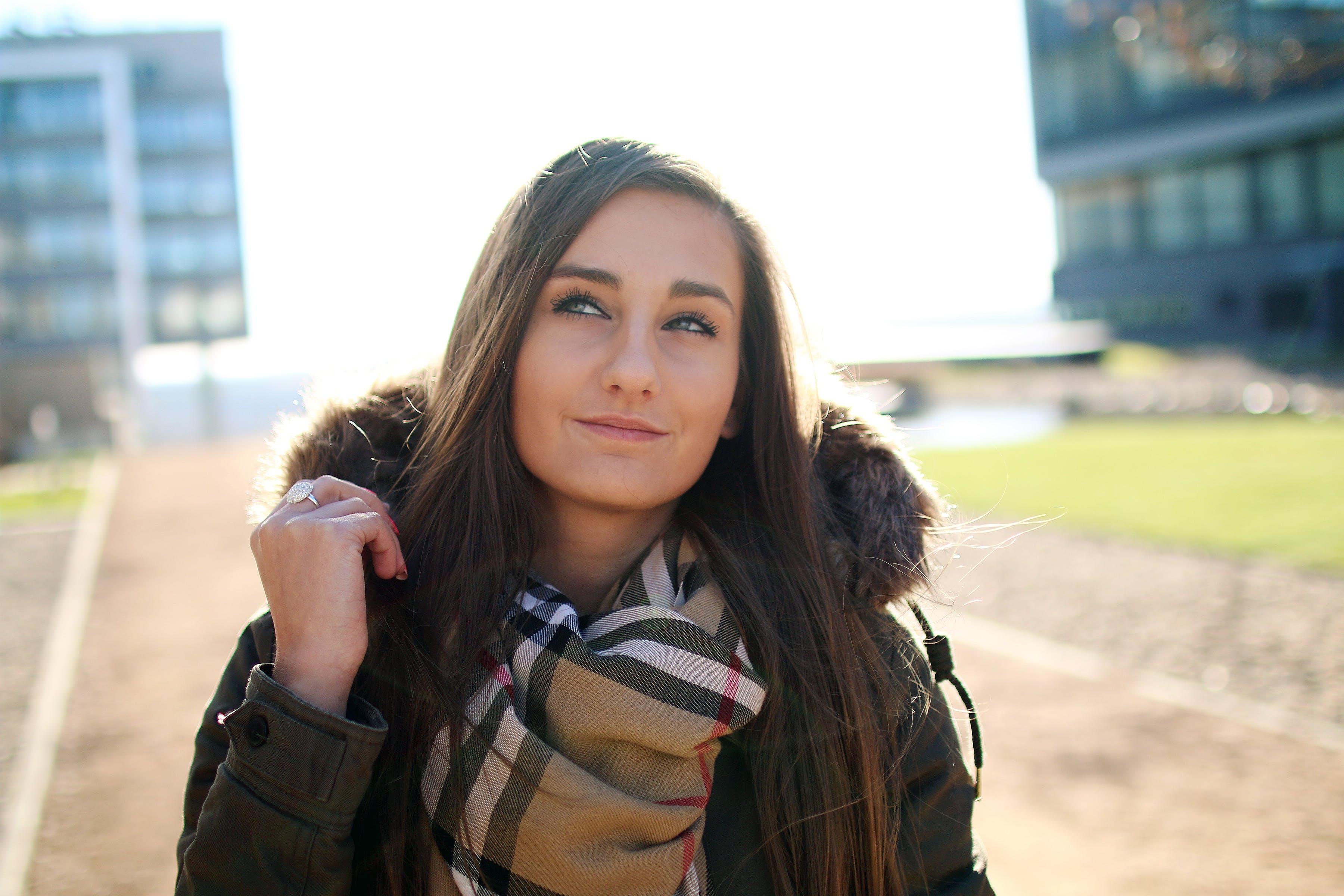 Woman Wearing Black Parka Jacket Smiling