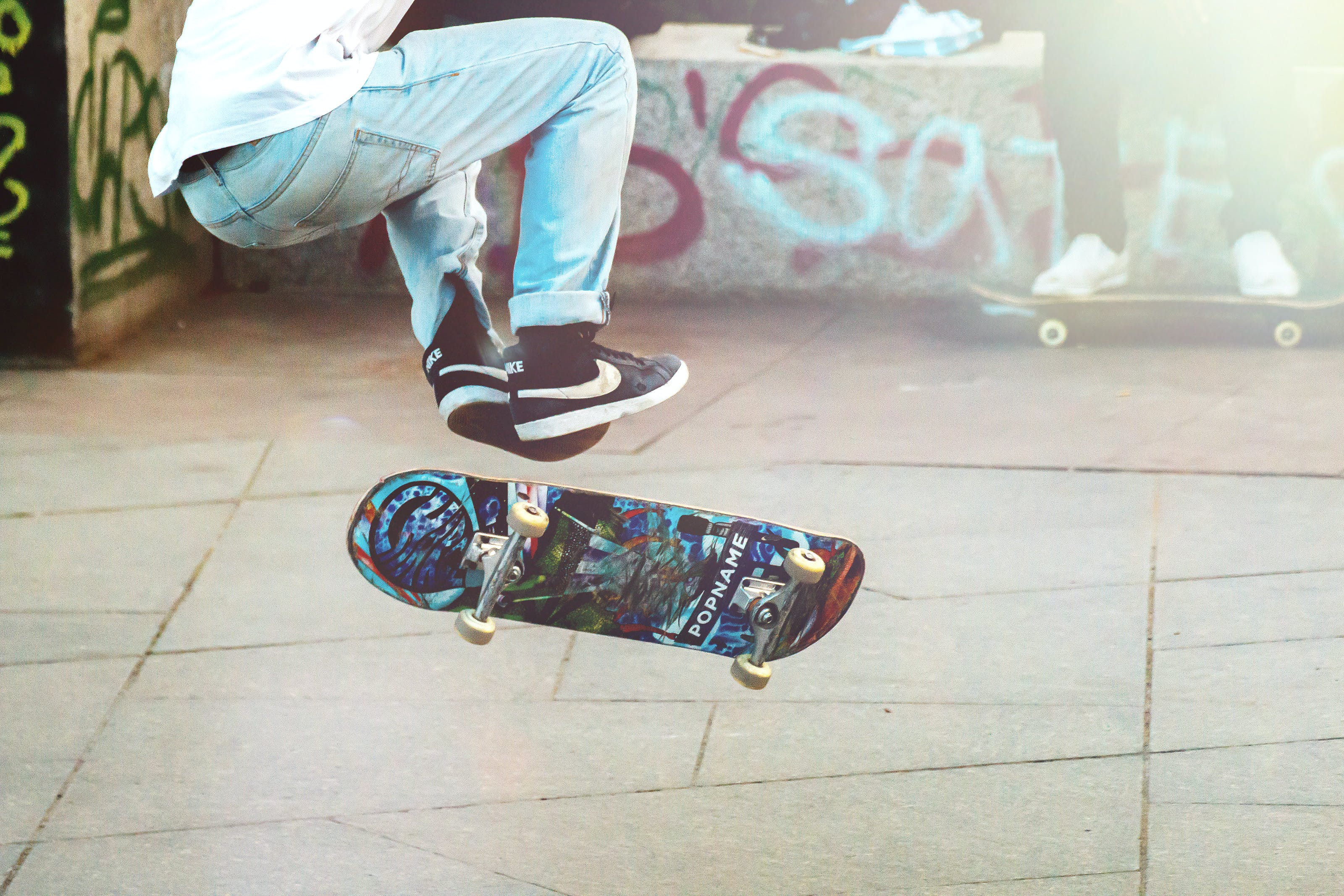 Person Performing Skateboard Tricks