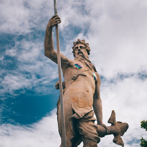 Statue of Neptune against blue sky