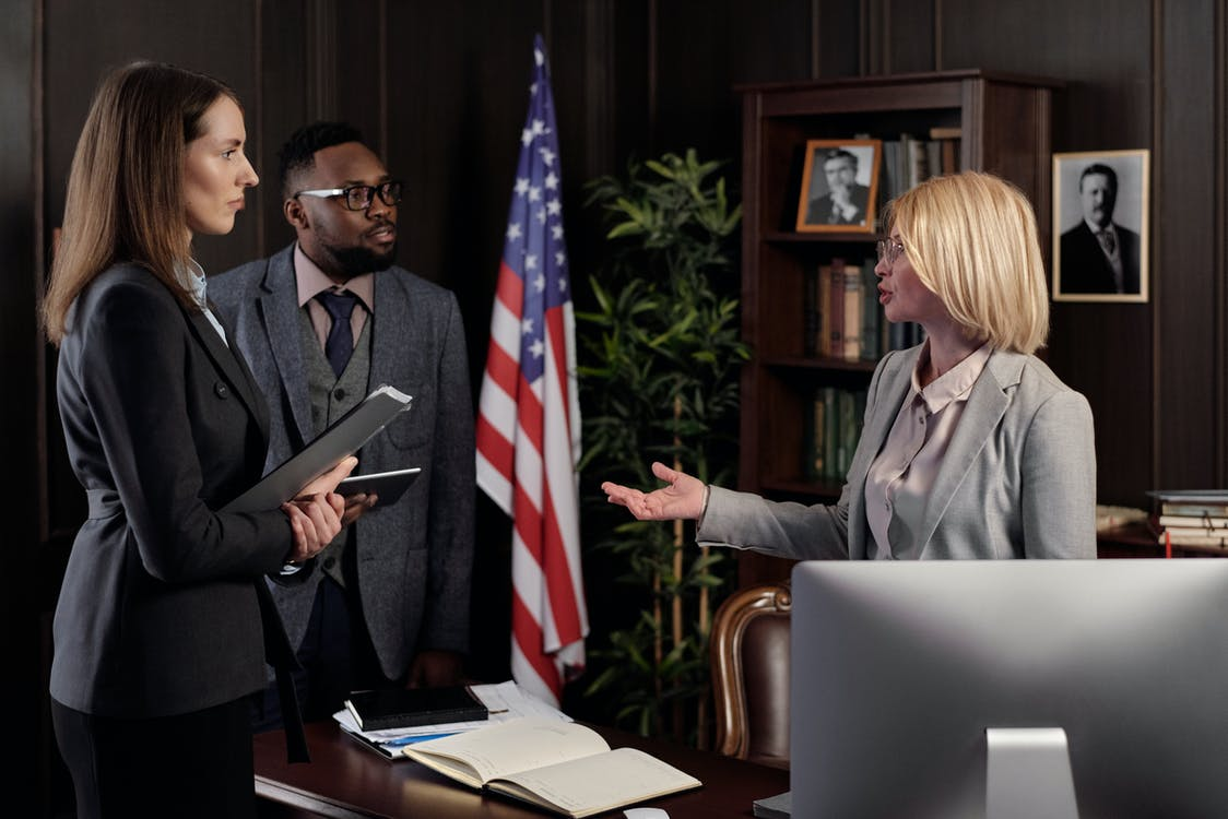 Lawyers Talking in an Office