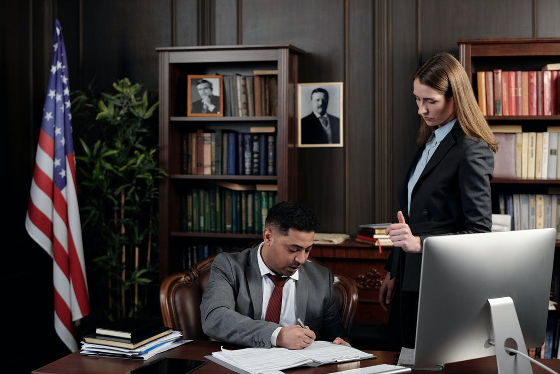 Lawyers in an Office Looking at Documents