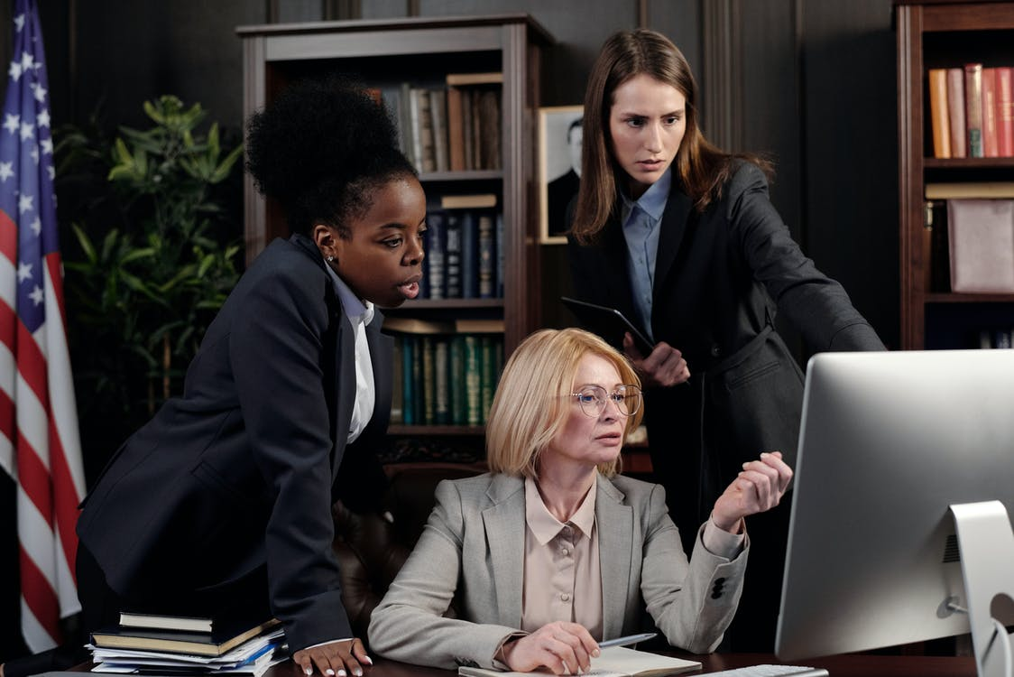 Businesswomen in an Office Looking at a Computer