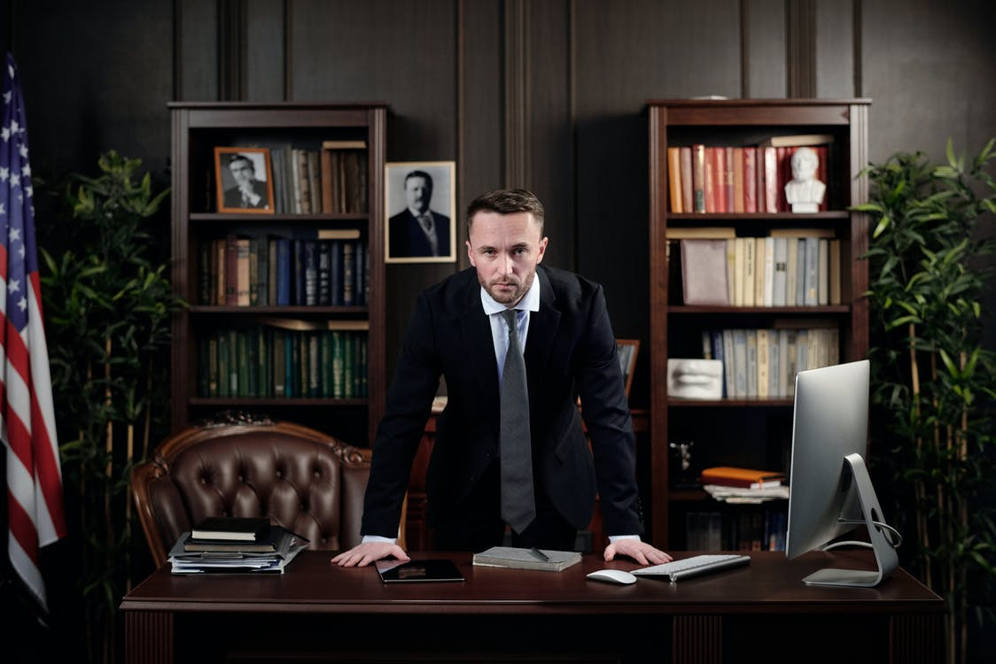 Businessman in his Office Looking at the Camera