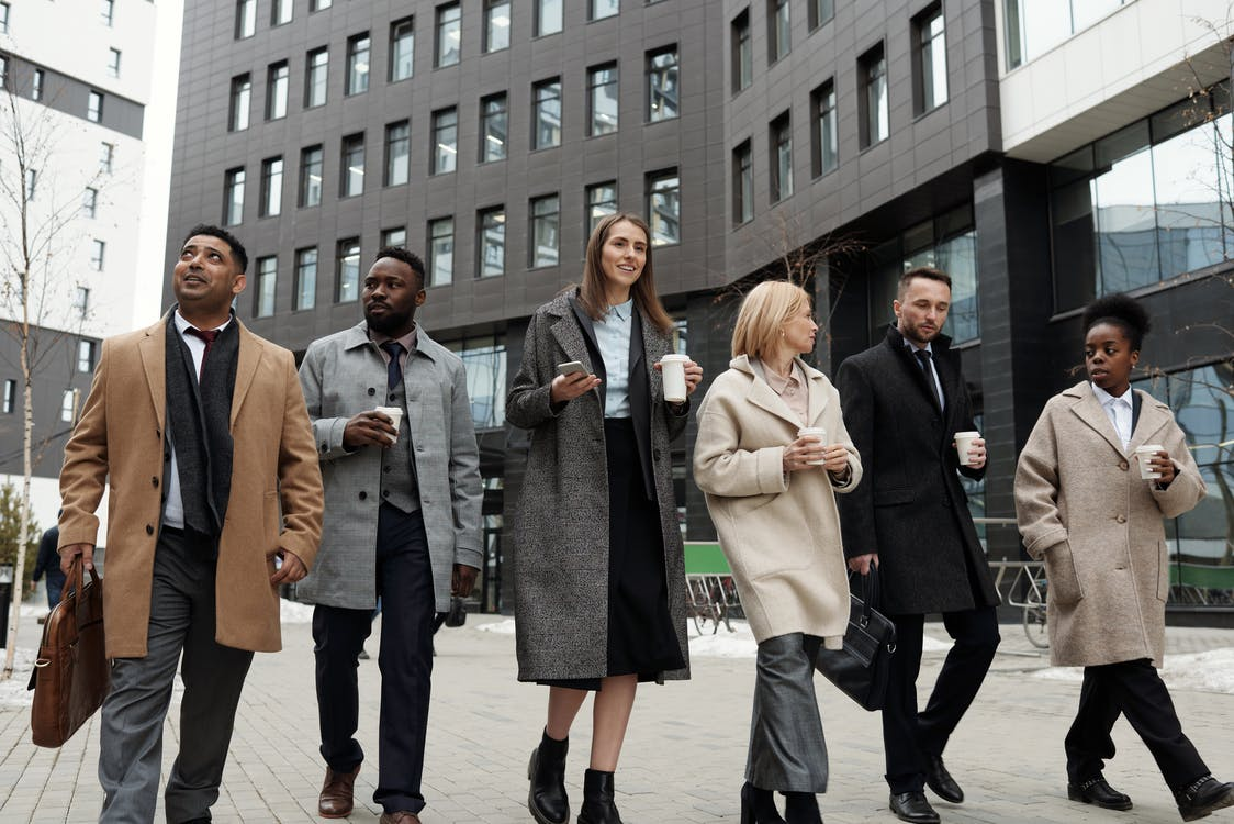 Coworkers Taking a Coffee Break and Walking