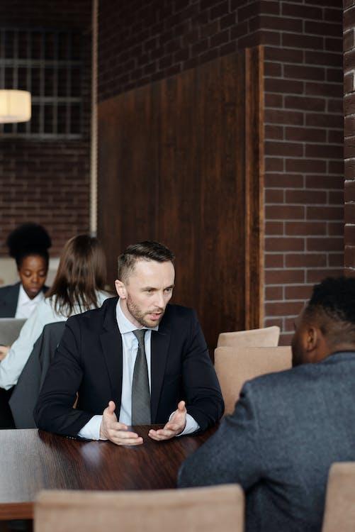 Businessmen Talking at a Cafe