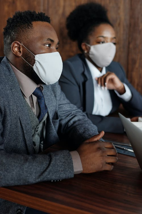 People in Business Suits with Face Masks