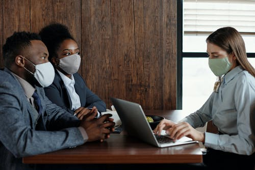 Business People Wearing Face Masks on a Meeting