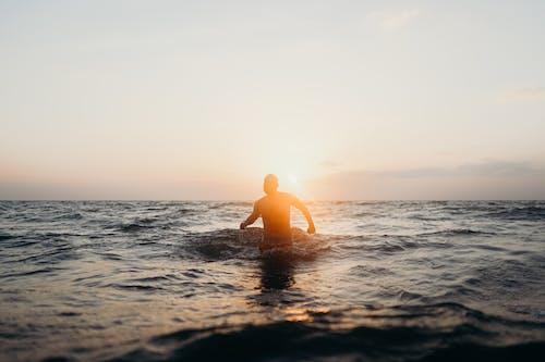 Man in Yellow Swimming Cap in Sea