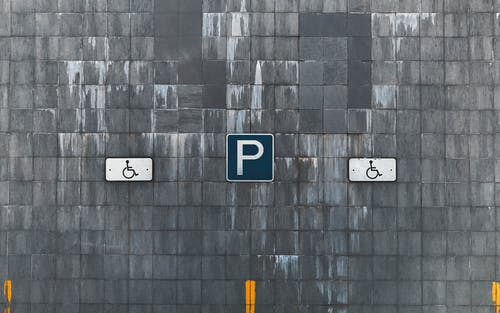 Free stock photo of brick wall, gray, street sign