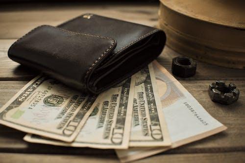 Black Leather Bifold Wallet on 100 Us Dollar Bill