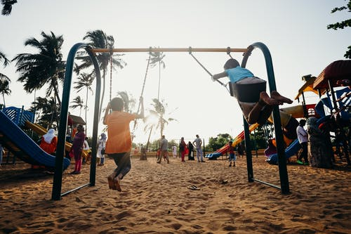 Children Playing on Swing