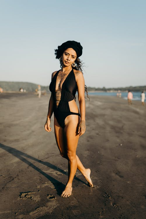 Woman in Black Bikini Standing on Beach