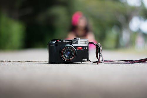 Retro photo camera on road in city