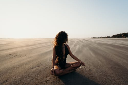 Woman Sitting on Sand