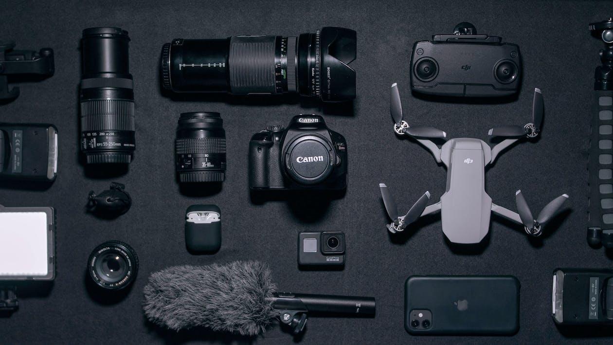 Black Nikon Dslr Camera Beside Black Dslr Camera