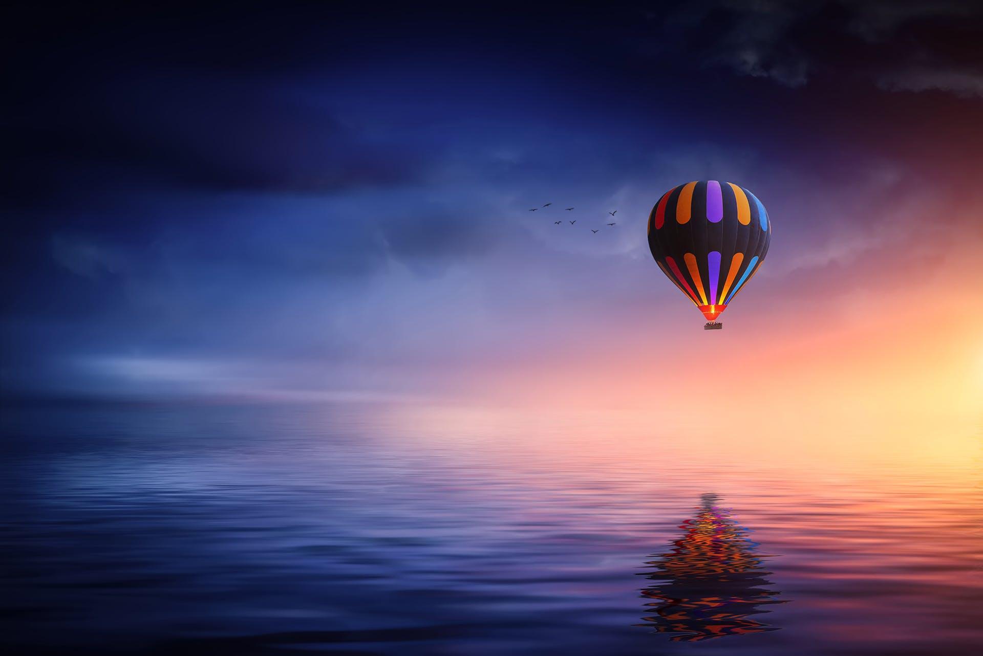 Multicolored Hot Air Balloon over Calm Sea