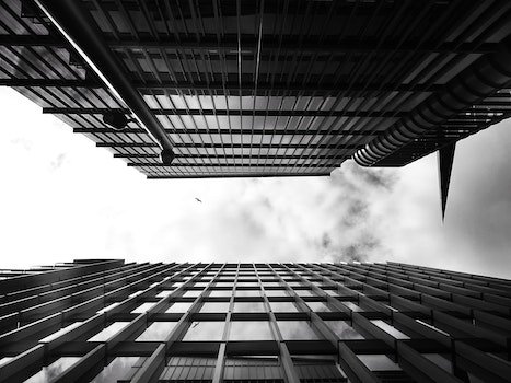 Free stock photo of black-and-white, sky, clouds, buildings