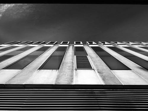 Grayscale Low-angle Photography of White Building