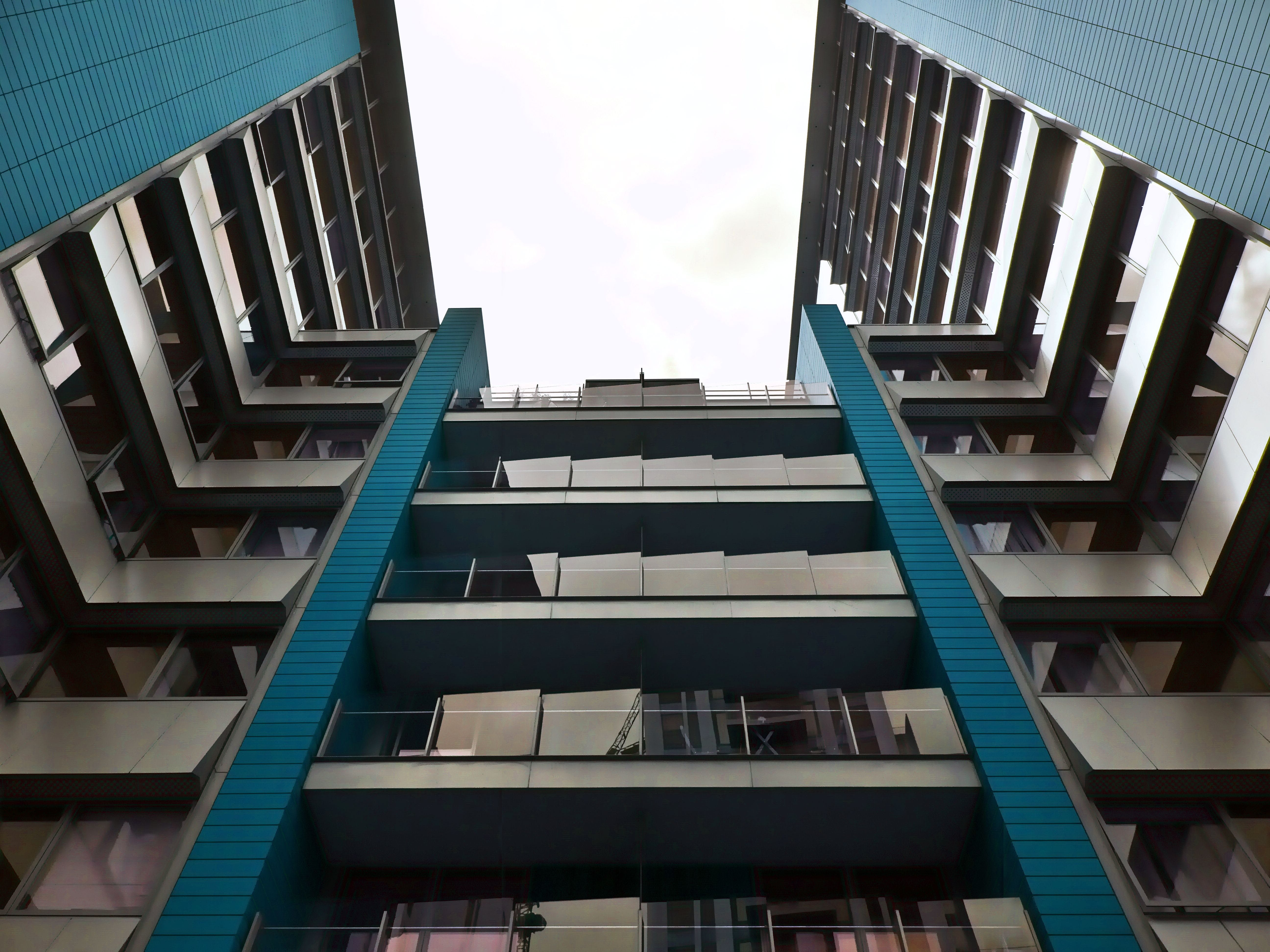 Low-angle Photography of Gray and Blue High-rise Building
