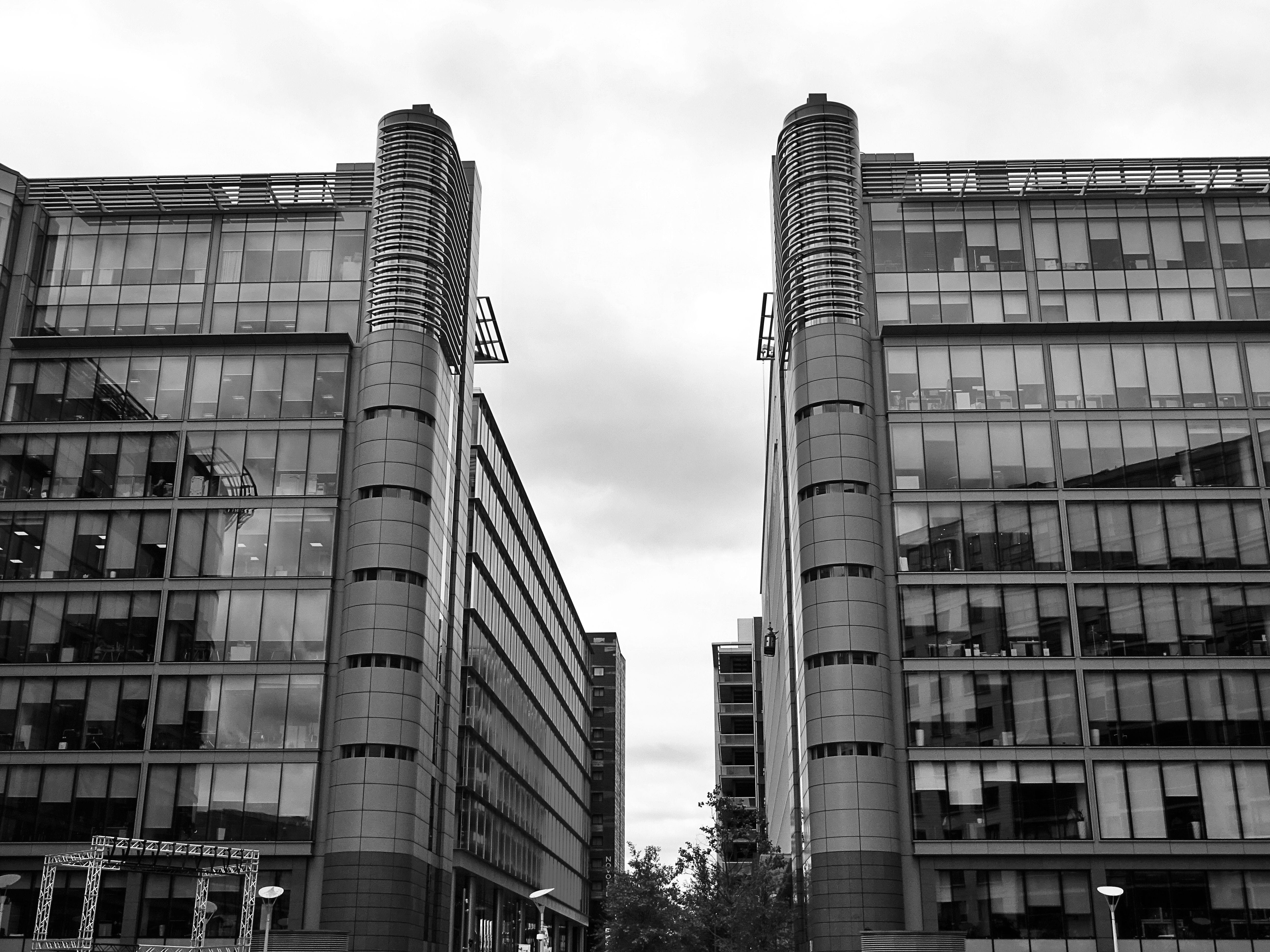 Grayscale Photo of Two Buildings