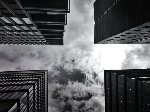 Low-angle Photography of Four Buildings