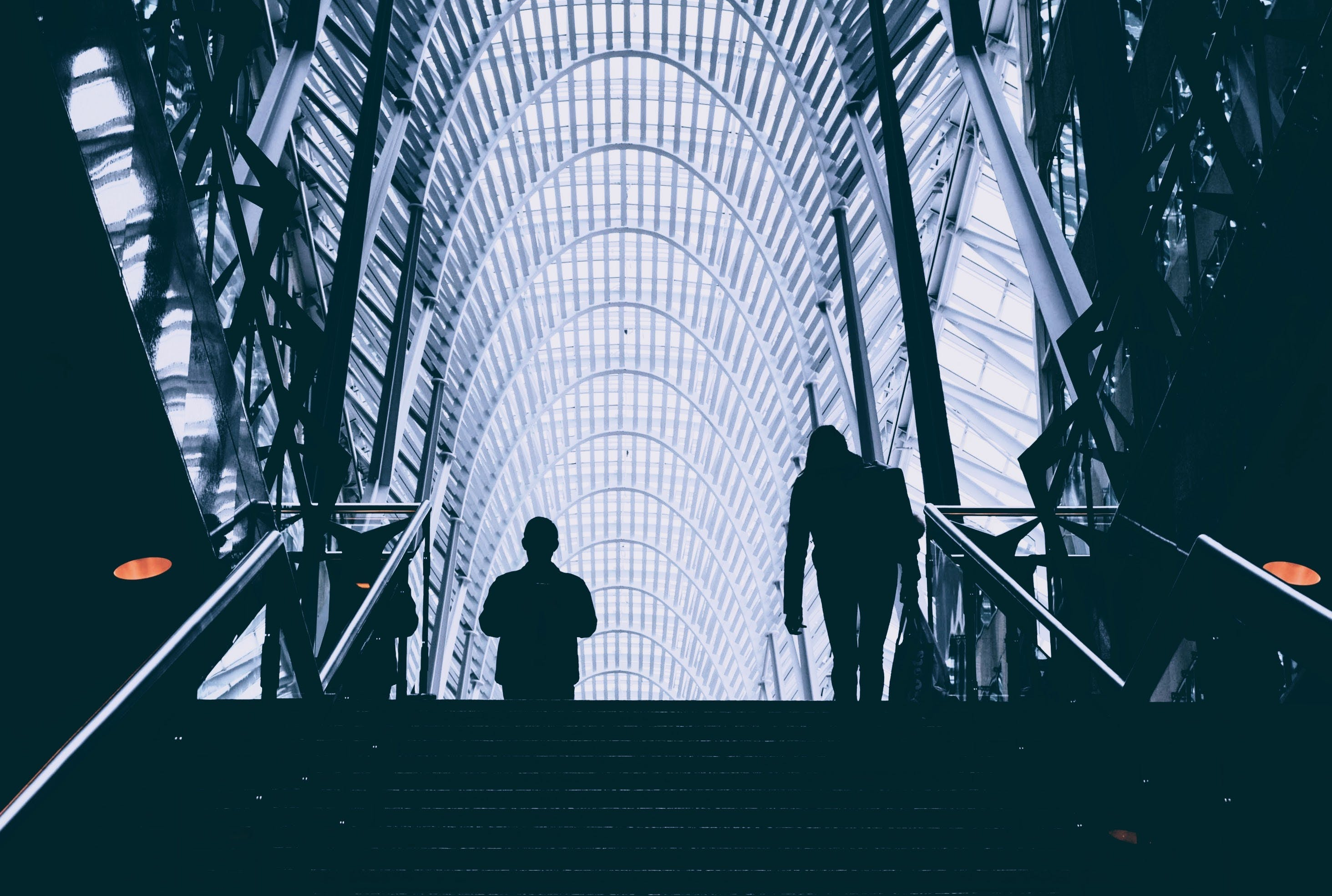 Man and Woman Walking on Stair